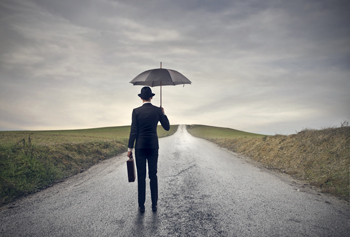 Man with umbrella on a long difficult journey