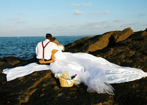 Newlyweds watching the ocean