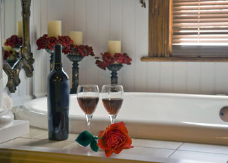 Romantic bath with champagne and roses