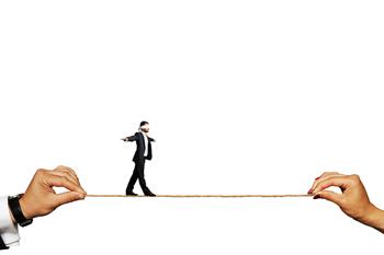man walking on tight rope blindfolded