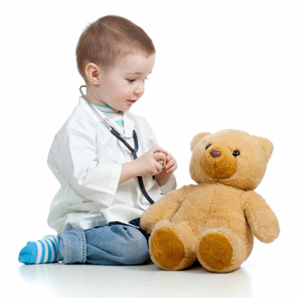 Boy playing doctor with his teddy bear