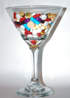 Cocktail glass full of supplement pills