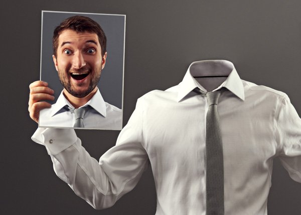 Man holding happy face