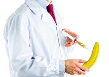 Doctor injecting banana