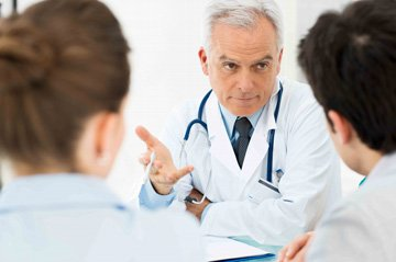 Couple seeing a doctor about Peyronie's disease