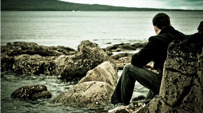 Young man looking out at sea